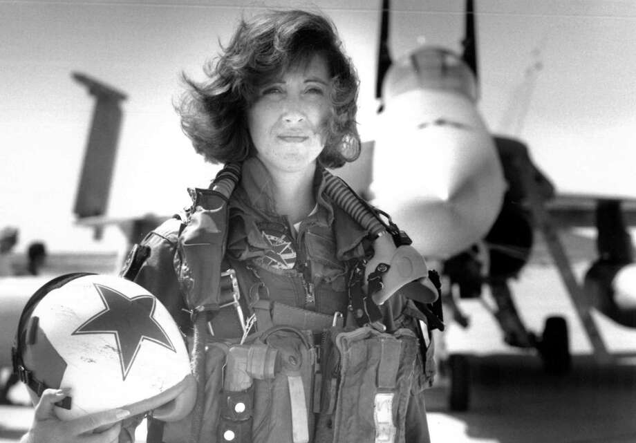 In this image provided by the U.S. Navy, Lt. Tammie Jo Shults, one of the first women to fly Navy tactical aircraft, poses in front of an F/A-18A with Tactical Electronics Warfare Squadron (VAQ) 34 in 1992. After leaving active duty in early 1993, Shults served in the Navy Reserve until 2001. Shults was the pilot of the Southwest plane that made an emergency landing on April 17, 2018, after an engine explosion. (Thomas P. Milne/U.S. Navy via AP) Photo: Thomas P. Milne, HOGP / Associated Press / U.S. Navy