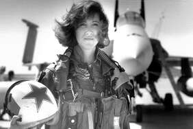In this image provided by the U.S. Navy, Lt. Tammie Jo Shults, one of the first women to fly Navy tactical aircraft, poses in front of an F/A-18A with Tactical Electronics Warfare Squadron (VAQ) 34 in 1992. After leaving active duty in early 1993, Shults served in the Navy Reserve until 2001. Shults was the pilot of the Southwest plane that made an emergency landing on April 17, 2018, after an engine explosion. (Thomas P. Milne/U.S. Navy via AP)