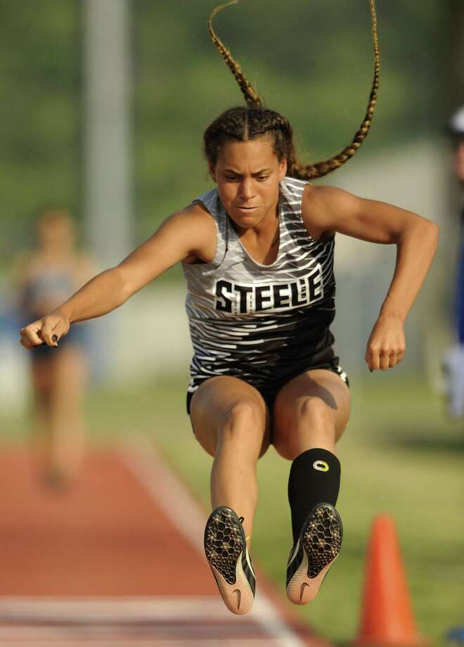 Keira Taylor-Mathis of Steele jumps to win the triple jump event at the area track meet at Gustafson Stadium on Wednesday, April 18, 2018. Photo: Billy Calzada, Staff / San Antonio Express-News / San Antonio Express-News