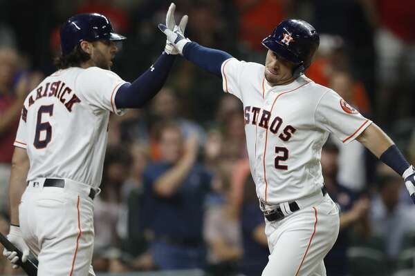 Houston Astros Alex Bregman (2) celebrates his home run with Jake Marisnick (6) in the fifth inning of an MLB game at Minute Maid Park, Tuesday, Aug. 1, 2017, in Houston. ( Karen Warren / Houston Chronicle )
