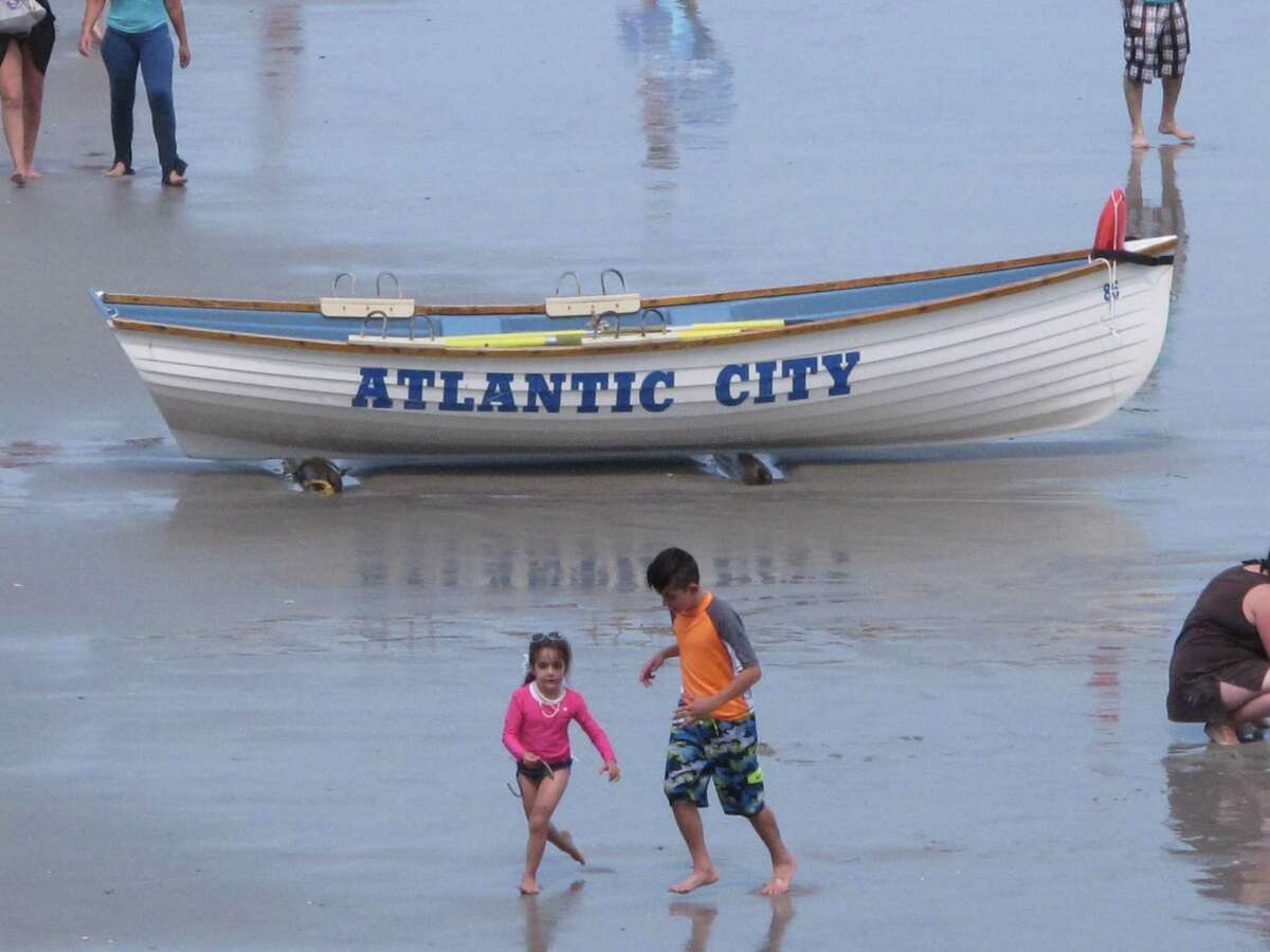 Tourists enjoy the beach in Atlantic City, N.J. on July 3, 2015, just before the Independence Day holiday.