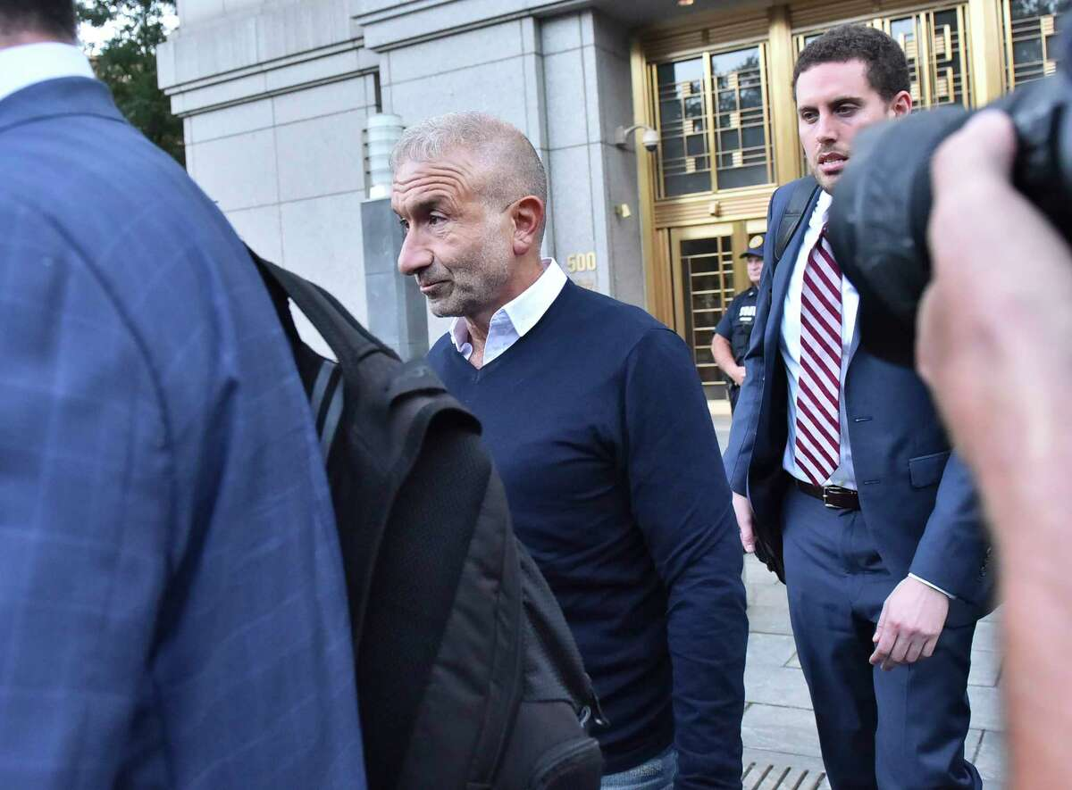 """Alain Kaloyeros, whom New York Gov. Andrew Cuomo once referred to as ?""""New York?'s secret weapon,?"""" leaves Federal District Court in New York, Sept. 22, 2016. Cuomo makes only cameo appearances in a federal complaint announced on Thursday that outlines a corruption scheme involving an ally, a former close aide and donors of his. (Louis Lanzano/The New York Times) ORG XMIT: XNYT151"""