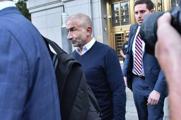 "Alain Kaloyeros, whom New York Gov. Andrew Cuomo once referred to as ""New York's secret weapon,"" leaves Federal District Court in New York, Sept. 22, 2016. Cuomo makes only cameo appearances in a federal complaint announced on Thursday that outlines a corruption scheme involving an ally, a former close aide and donors of his. (Louis Lanzano/The New York Times) ORG XMIT: XNYT151"