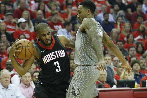 Houston Rockets guard Chris Paul (3) clashes with Minnesota Timberwolves guard Jeff Teague (0) during the first half of Game 2 of an NBA basketball first-round playoff series at Toyota Center on Wednesday, April 18, 2018, in Houston. ( Brett Coomer / Houston Chronicle )
