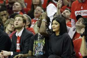 HOUSTON, TX - APRIL 18:  Rapper Travis Scott and Kylie Jenner watch from court side during Game Two of the first round of the Western Conference playoffs at Toyota Center on April 18, 2018 in Houston, Texas. NOTE TO USER: User expressly acknowledges and agrees that, by downloading and or using this photograph, User is consenting to the terms and conditions of the Getty Images License Agreement.