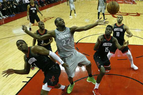 Minnesota Timberwolves forward Andrew Wiggins (22), Houston Rockets center Clint Capela (15), and guard Joe Johnson (7) look at the ball as they tried to rebound during the first half of Game 2 of an NBA basketball first-round playoff series at Toyota Center on Wednesday, April 18, 2018, in Houston. ( Brett Coomer / Houston Chronicle )
