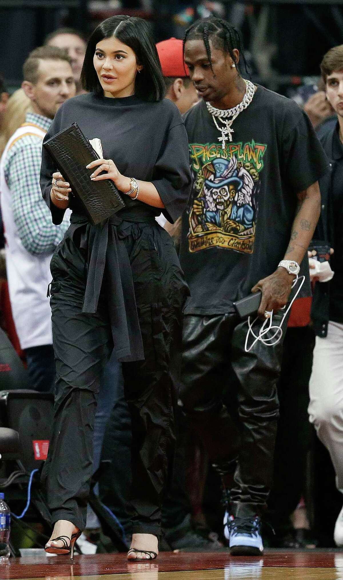 Kylie Jenner, left, and Travis Scott walks to their seats during the second half in Game 2 of a first-round NBA basketball playoff series between the Houston Rockets and the Minnesota Timberwolves, Wednesday, April 18, 2018, in Houston. (AP Photo/Eric Christian Smith) >> How Twitter reacted to Kylie Jenner's baby name.