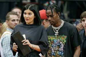Kylie Jenner, left, and Travis Scott walks to their seats during the second half in Game 2 of a first-round NBA basketball playoff series between the Houston Rockets and the Minnesota Timberwolves, Wednesday, April 18, 2018, in Houston. (AP Photo/Eric Christian Smith)