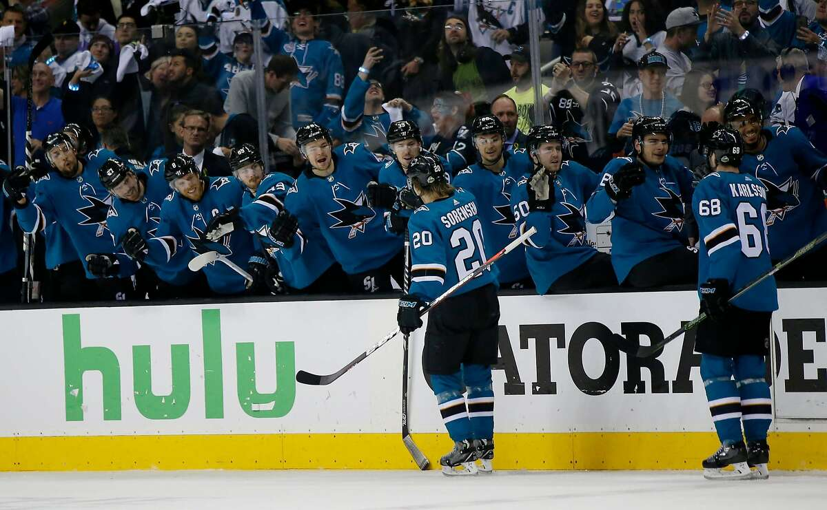 San Jose Sharks' Marcus Sorensen (20) celebrates with bench after scoring goal against Anaheim Ducks in the first period of Game 4 of an NHL first round playoff series on Wednesday, April 18, 2018 at the SAP Center in San Jose, California.