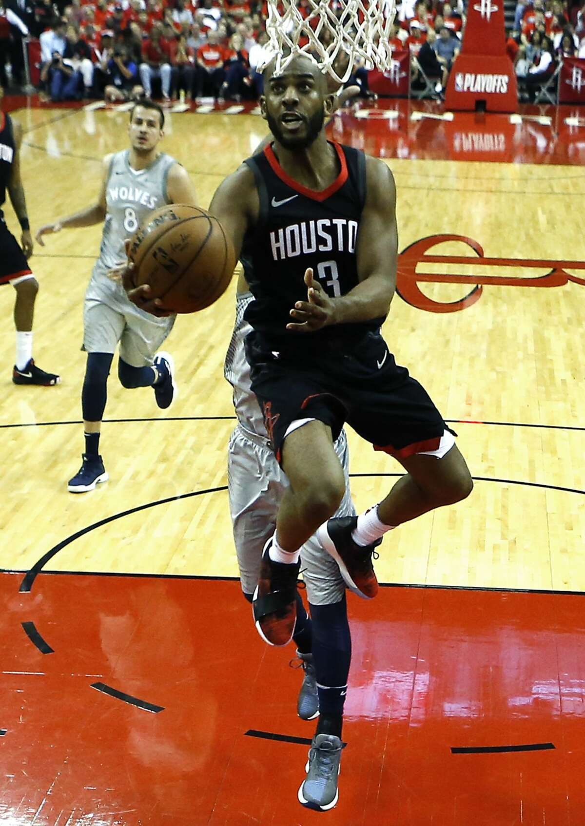 Houston Rockets guard Chris Paul (3) drives to the basket for a layup against the Minnesota Timberwolvesm during the second half of Game 2 of an NBA basketball first-round playoff series at Toyota Center on Wednesday, April 18, 2018, in Houston. ( Brett Coomer / Houston Chronicle )