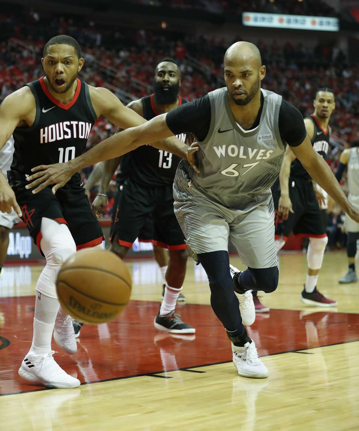 Minnesota Timberwolves forward Taj Gibson (67) and Houston Rockets guard Eric Gordon (10) watch a ball go out of bounds during the second half of Game 2 of an NBA basketball first-round playoff series at Toyota Center on Wednesday, April 18, 2018, in Houston. ( Brett Coomer / Houston Chronicle )