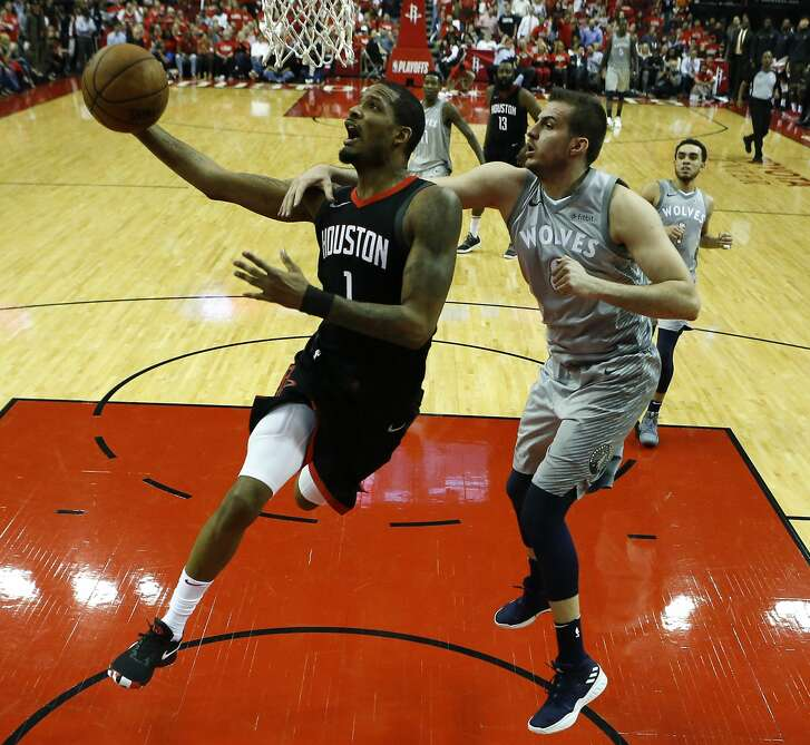 Houston Rockets forward Trevor Ariza (1) drives to the basket past Minnesota Timberwolves forward Nemanja Bjelica (8) during the second half of Game 2 of an NBA basketball first-round playoff series at Toyota Center on Wednesday, April 18, 2018, in Houston. ( Brett Coomer / Houston Chronicle )