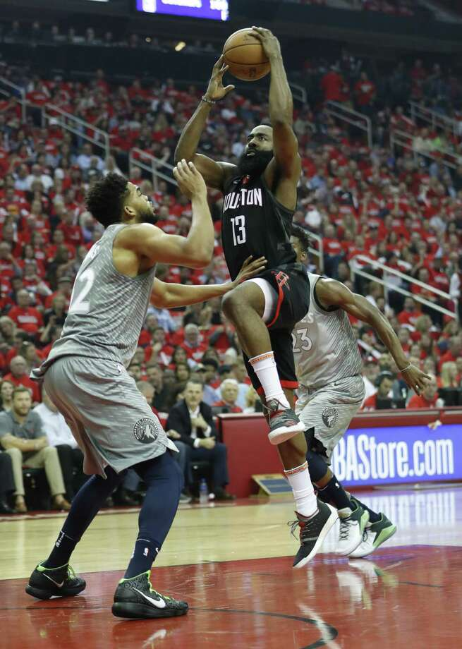 Rockets guard James Harden finds a path to the basket but is challenged by Timerwolves center Karl-Anthony Towns during the first half of Game 2 on Wednesday night. Photo: Brett Coomer, Staff / Houston Chronicle / © 2018 Houston Chronicle