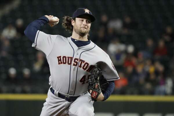 Houston Astros starting pitcher Gerrit Cole throws to a Seattle Mariners batter dyrubg the first inning of a baseball game Wednesday, April 18, 2018, in Seattle. (AP Photo/Ted S. Warren)