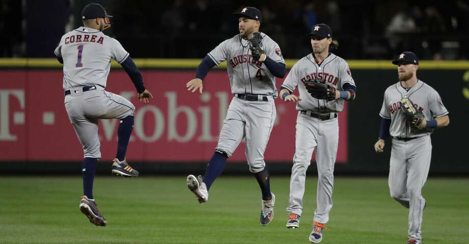Houston Astros' Carlos Correa, George Springer, Josh Reddick and Derek Fisher, from left, celebrate after the Astros defeated the Seattle Mariners 7-1 in a baseball game Wednesday, April 18, 2018, in Seattle. (AP Photo/Ted S. Warren) Photo: Ted S. Warren/Associated Press