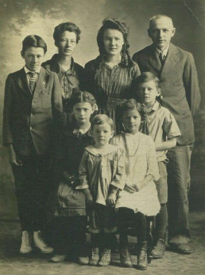 Mae and Paul Kuhn pose with their six children. Carol wasn't born yet. In the back, from left, are Kenneth, mom Mae, Pauline, and dad Paul. In the front, from left, are Claressa, Sterling next to Claressa, then Katie and in back of her is Gettis. Of the seven Kuhn children, only Claressa stayed on the ranch.