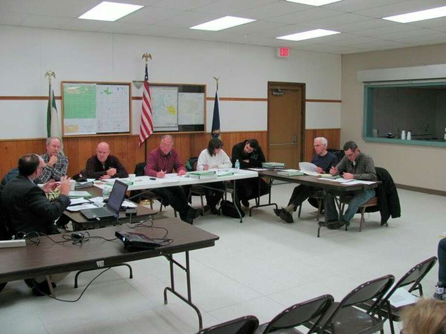 The Ingersoll Township Planning Commission discusses its wind ordinance at a recent meeting.