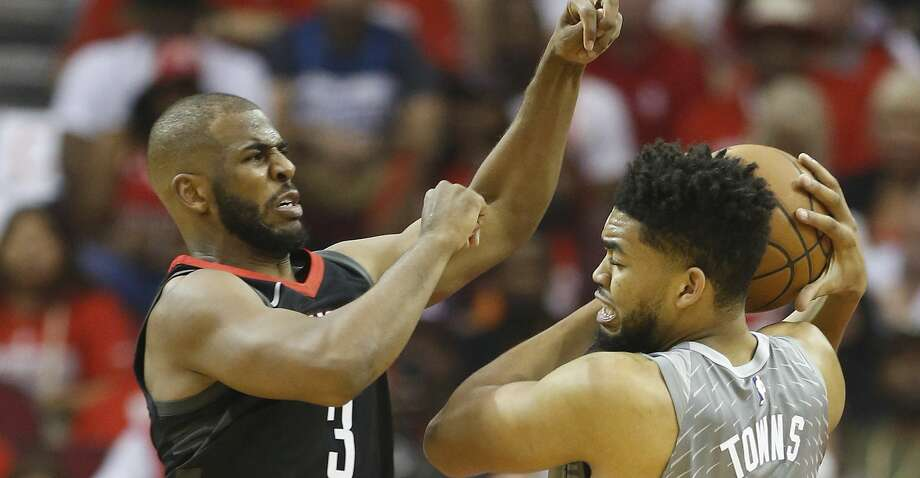 Houston Rockets guard Chris Paul (3) battles against Minnesota Timberwolves center Karl-Anthony Towns (32) during the first half of Game 2 of an NBA basketball first-round playoff series at Toyota Center on Wednesday, April 18, 2018, in Houston. ( Brett Coomer / Houston Chronicle ) Photo: Brett Coomer/Houston Chronicle