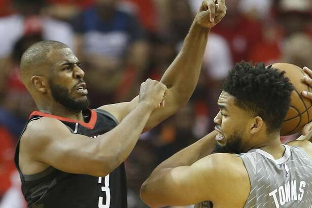 Houston Rockets guard Chris Paul (3) battles against Minnesota Timberwolves center Karl-Anthony Towns (32) during the first half of Game 2 of an NBA basketball first-round playoff series at Toyota Center on Wednesday, April 18, 2018, in Houston. ( Brett Coomer / Houston Chronicle )