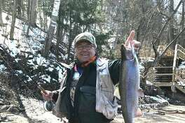 Terry McCleery, of Roscommon, poses happily with a steelhead caught on the Manistee River last week with center pin gear.(Steve Griffin/Hearst Michigan)