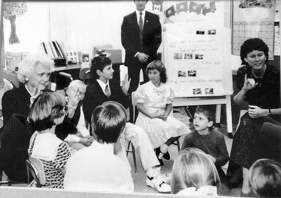 Former first lady Barbara Bush speaks to students in Sue Brosmith's sibling sign language class on October 25, 1988, at the Illinois School for the Deaf. Photo:       Julie Zook | Journal-Courier File