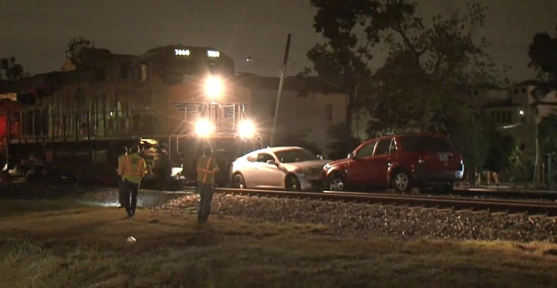 Train hits two empty cars on tracks in Washington Avenue area - Houston Chronicle