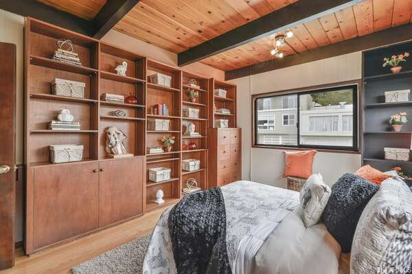 Top-floor master with built-ins and small en suite.