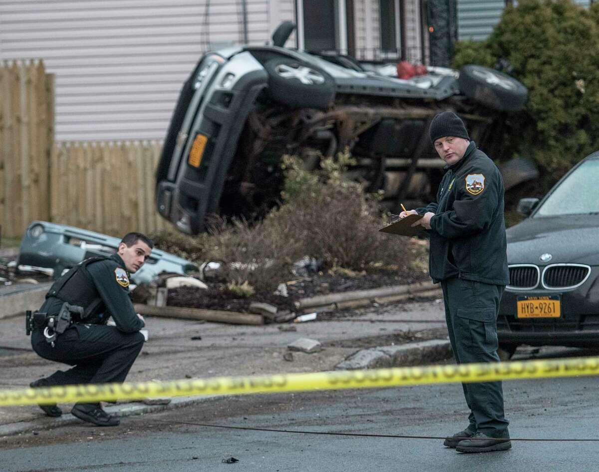 Schenectady Police are investigating an accident that caused damage to multiple houses and sent three people to local hospitals early Thursday April 19, 2018 in Schenectady, N.Y. (Skip Dickstein/Times Union)