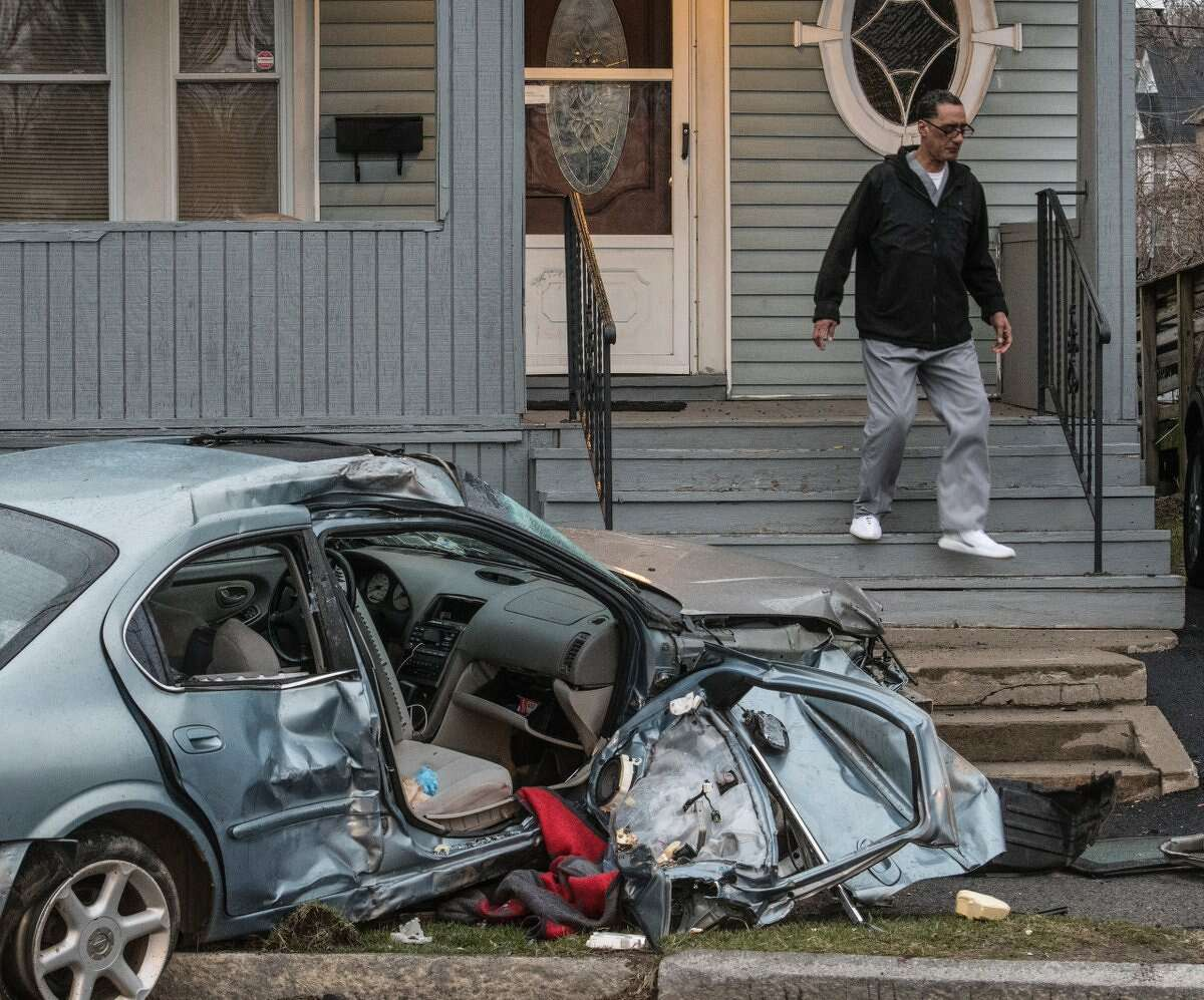 Schenectady police investigate an overnight crash on Thursday that sent at least one vehicle crashing into a porch.