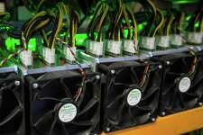 """(FILES) In this file photo taken on March 19, 2018 Bitcoin being mined at Bitfarms in Saint Hyacinthe, Quebec on March 19, 2018. At a former cocoa factory in Canada's Quebec province, tiny holes punctured in the walls allow fresh outside air to cool the thousands of whirring computer processors connected by a tangle of wires at Bitfarms, in a nondescript warehouse in Saint-Hyacinthe's industrial park, east of Montreal. / AFP PHOTO / Lars Hagberg / TO GO WITH AFP STORY by Clement Sabourin, """"Canada-cryptocurrency-computers-electricity""""LARS HAGBERG/AFP/Getty Images"""