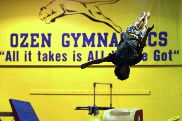 Ozen's Rani Bentley practices tumbling during gymnastics class at Ozen. Photo taken Tuesday, April 17, 2018 Guiseppe Barranco/The Enterprise