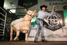 Montgomery FFA's Colton Carwile shows his grand champion steer during the Montgomery County Fair Junior Livestock Auction on Wednesday, April 18, 2018, at the Lone Star Convention Center.