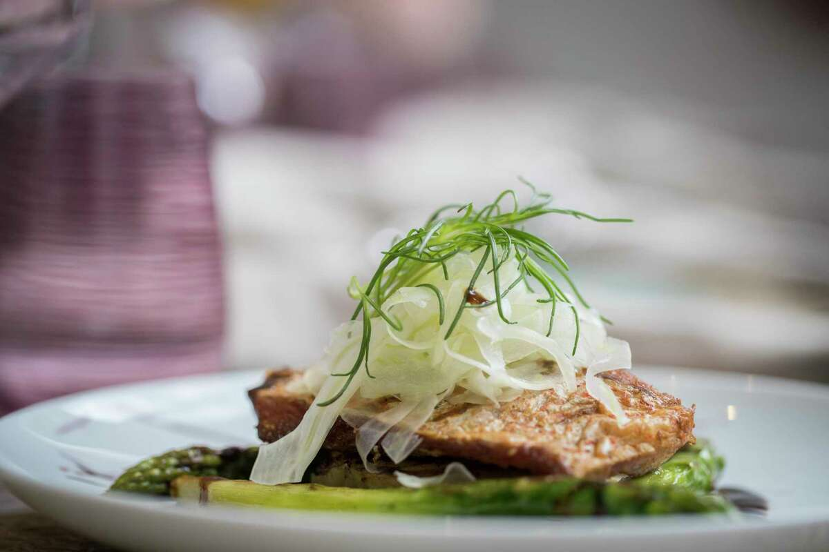Bloom & Bee's Gulf Red Snapper Fillet prepared with potato leak cake, jumbo asparagus and brown butter balsamic emulsion.