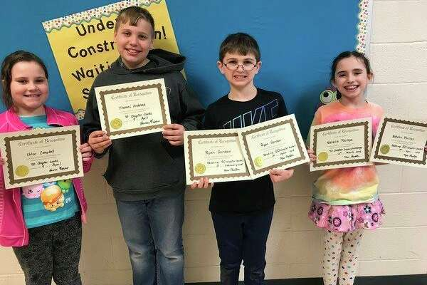 Chloe Campbell, Thomas Knoblock, Ryan Gordon Natalie Phillips recently set reading records at North Huron. (Submitted Photo)