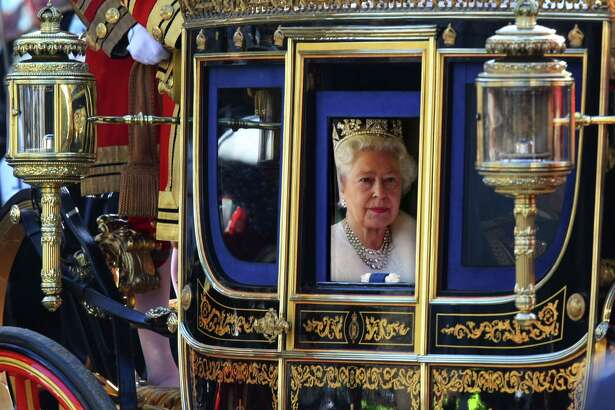 Queen Elizabeth looks out of her carriage as she returns from the Houses of Parliament in London on Nov. 6, 2007.