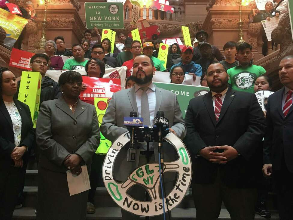 Activists and Assembly members, including Assemblyman Marcos Crespo (center), rally in the Capitol on Wednesday for legislation allowing undocumented New Yorkers to obtain drivers' licenses.
