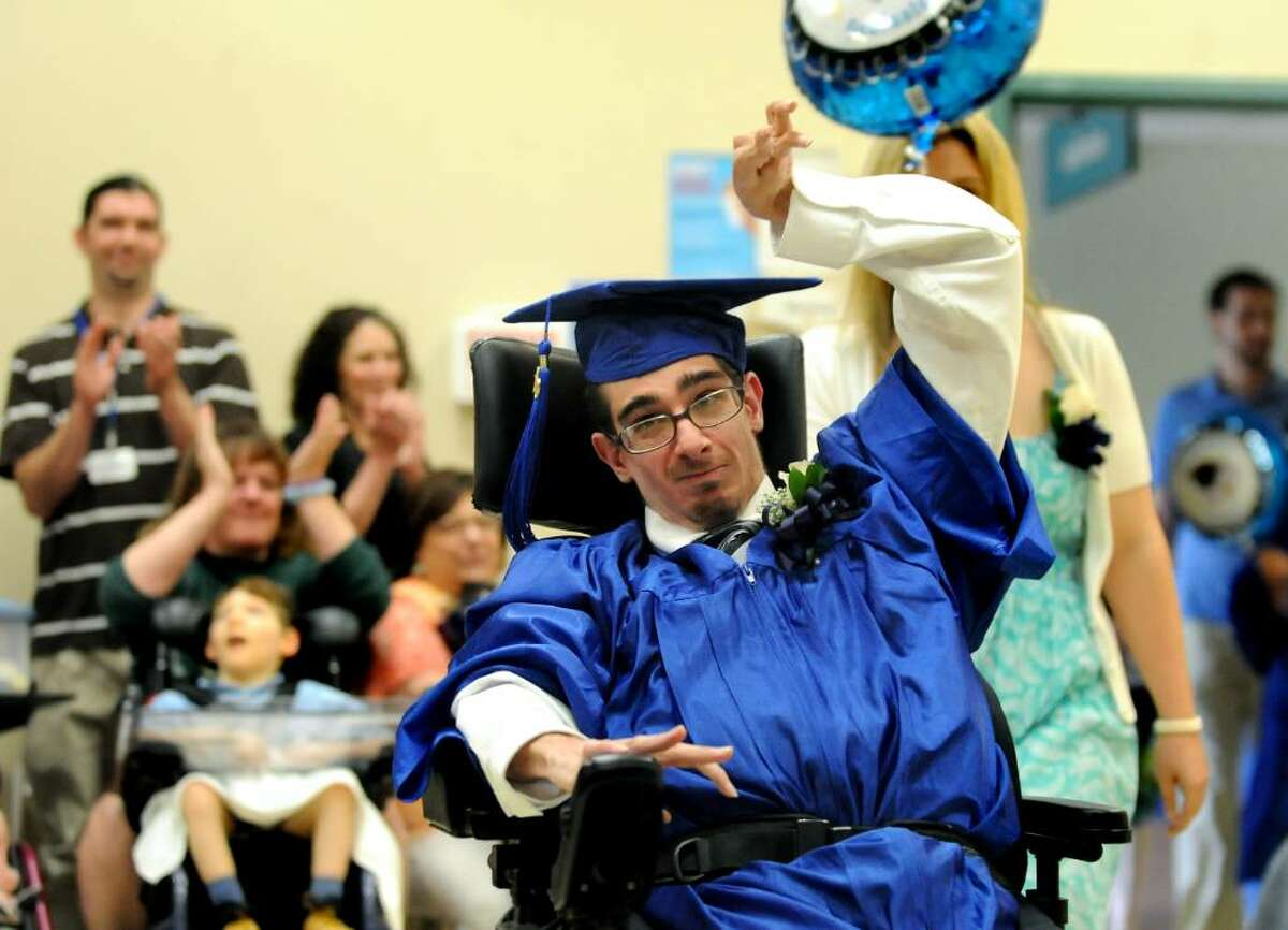 Langan School graduate David Nichols, center, enters the auditorium during commencement exercises on Tuesday, June 22, 2010, at the Center for Disability Services in Albany. (Cindy Schultz / Times Union)