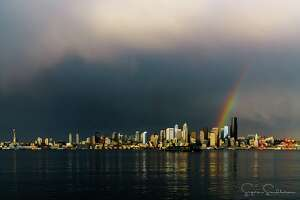 The Seattle sky stunned on Wednesday night when a rainbow appeared at sunset. Many shared photos in social media.