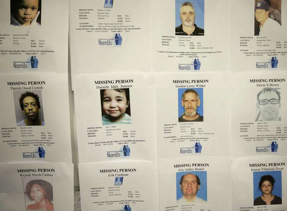 Missing person flyer are displayed on the wall during the Missing In Harris County Day event held at the Houston Food Bank, 535 Portwall Street, Saturday, June 10, 2017, in Houston. Relatives who are looking for a missing person were invited to Missing in Harris County Day to connect with the Harris County Institute of Forensic Sciences and organizations dedicated to locate the missing.  ( Melissa Phillip / Houston Chronicle ) Photo: Melissa Phillip, Staff / Houston Chronicle / Internal