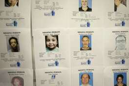 Missing person flyer are displayed on the wall during the Missing In Harris County Day event held at the Houston Food Bank, 535 Portwall Street, Saturday, June 10, 2017, in Houston. Relatives who are looking for a missing person were invited to Missing in Harris County Day to connect with the Harris County Institute of Forensic Sciences and organizations dedicated to locate the missing.  ( Melissa Phillip / Houston Chronicle )