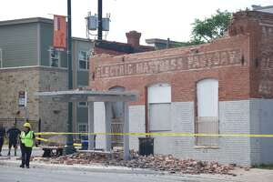 An abandoned building at East Commerce and North Olive collapsed on the East Side on Thursday, April 19, 2018.