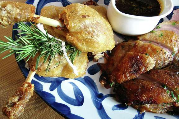 A dish of whole duck with confit leg quarters and roasted breast from Maverick Texas Brasserie.