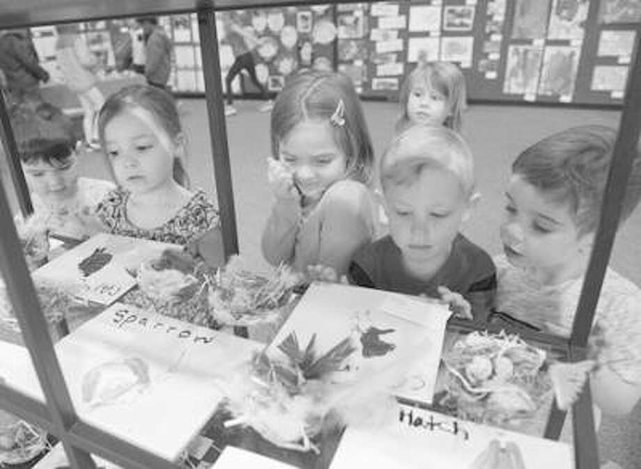 From left, Henry, Willow, Norah, Wyatt and Judah gaze at beautiful bird artwork during the SIUE Early Childhood Center's 8th Annual Art Exhibit. Photo:       For The Telegraph
