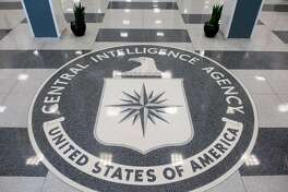 """This file photo taken on August 13, 2008 shows the seal of the Central Intelligence Agency (CIA) in the lobby of CIA Headquarters in Langley, Virginia. Kingston dentist Gilberto Nunez, cleared of killing his lover's husband but convicted of showing the women forged CIA documents and claiming he was a """"special agent"""" failed in his bid to convince an appeals court that his conviction on charges of possession of a forged instrument should be overturned because the assertion he was in the CIA was too absurd to be believable."""