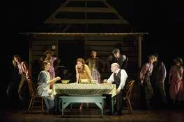 "A dinner scene from the musical ""Bright Star."""