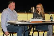Westport Board of Finance members James Westphal and Sheri Gordon discuss the school budget at the April 18 Board of Finance meeting.