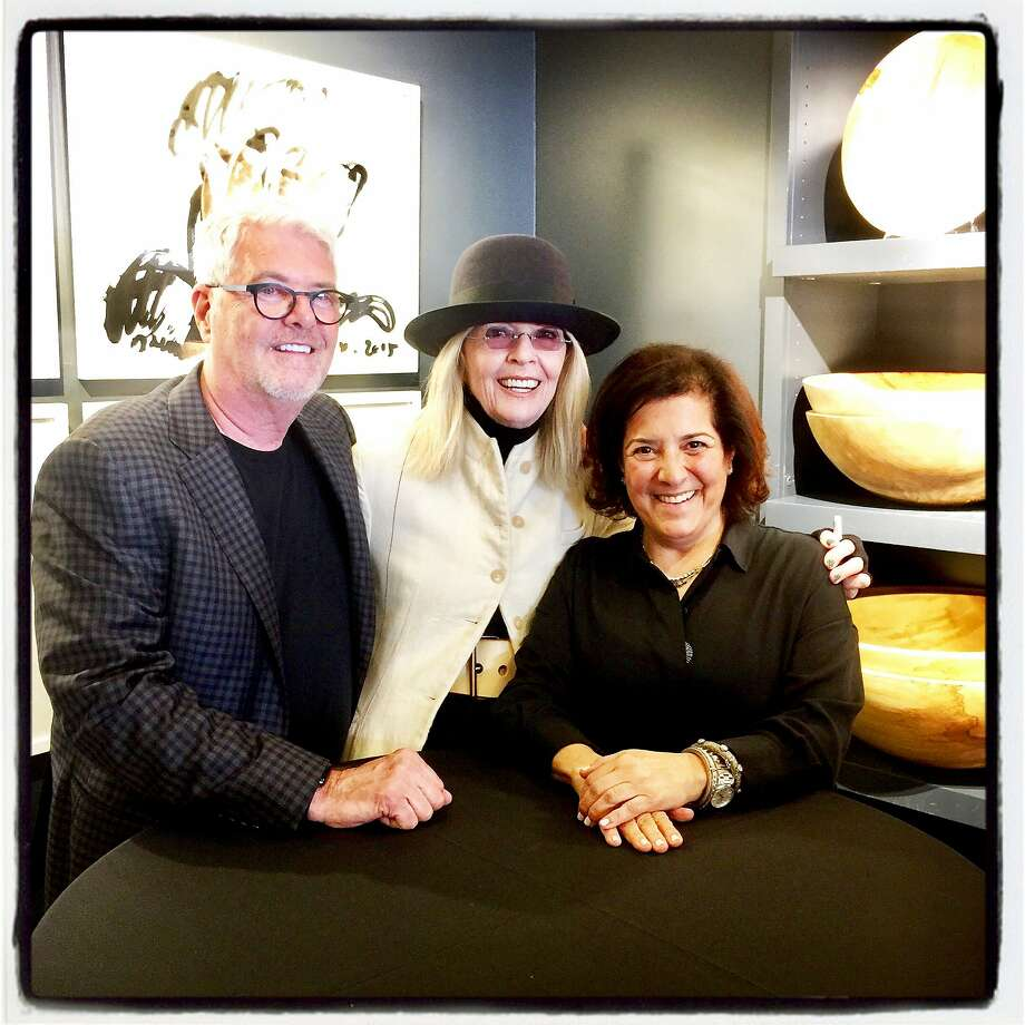 Author Diane Keaton (center) signs copies of her new book at Hudson Grace with proprietors Gary McNatton and Monelle Totah on April 17, 2018. Photo: Catherine Bigelow / Special To The Chronicle