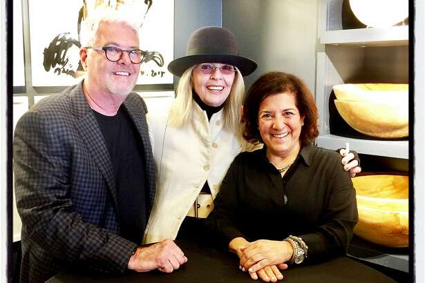 Author Diane Keaton (center) signs copies of her new book at Hudson Grace with proprietors Gary McNatton and Monelle Totah. April 17, 2018.