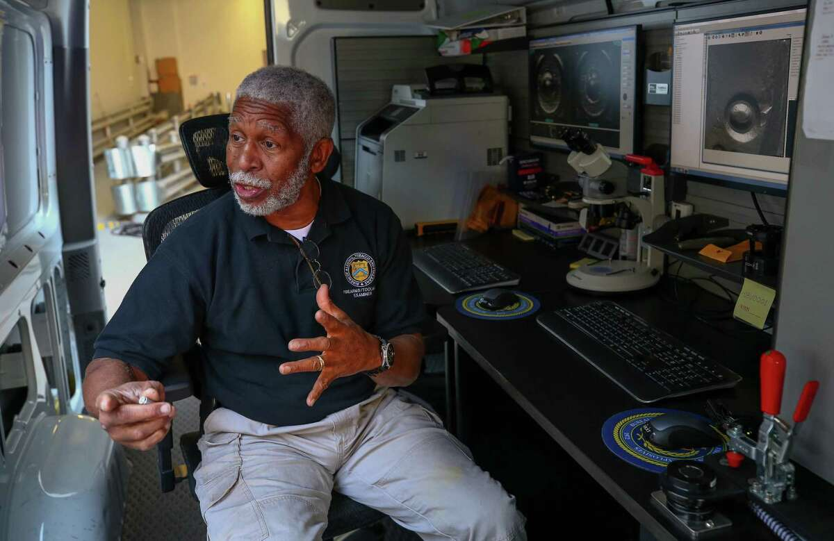 Bureau of Alcohol, Tobacco, Firearms and Explosives firearms and tool mark examiner Walter Deandridge talks about the ability to analyze bullet casings inside the mobile National Integrated Ballistic Information Network (NIBIN) van Thursday, April 19, 2018, in Houston. The ATF Houston Field Division and the Houston Police Department unveiled the NIBIN van Thursday. Police hope the unit will help them respond to shooting cases more quickly, and is part of an effort by the federal agency to help local municipalities crack down on gun crime.