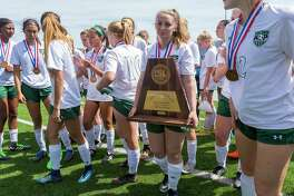 Humble Kingwood Park's Kristina McKillop stands with their third place trophy after falling to Frisco Wakeland during the Class 5A girls soccer state semifinal in Georgetown, Thursday, April 19, 2018.